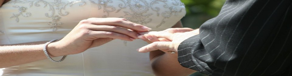 Bride and groom's hands being joined in marriage