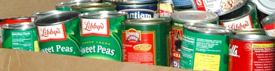 Cans of food in a cardboard box